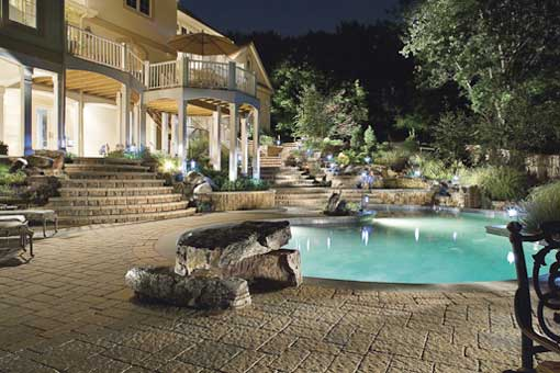 crescent dc techo bloc pool at night with jumping diving board made
